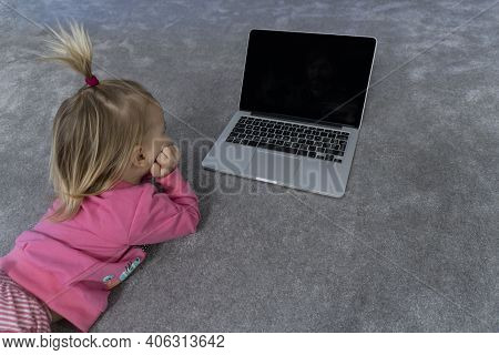 Cute Little Blonde Caucasian Baby Girl Laying At Gray Rug And Watching At Laptop, Modern Digital Gen