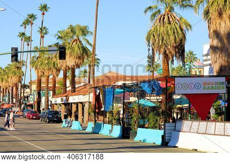 February 2, 2021 In Palm Springs, Ca:  Restaurants With Outdoor Patio Seating Besides Palm Trees On