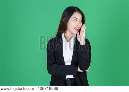 Smiling Young Asian Business Woman With Hand Over Ear Listening An Hearing To Hearsay Or Rumor. Secr