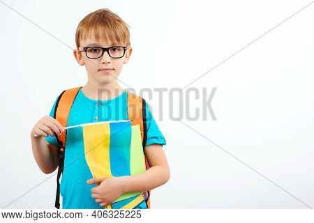 Schoolboy Learning Ukrainian Language. Cute Boy With Backpack Holding Ukrainian Flag. People, Educat