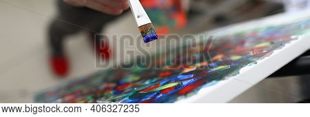 Close-up Of Persons Hand Creating Abstract Painting On Canvas Combine Different Styles. Picture With