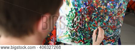 Close-up Of Persons Hand Creating Abstract Painting On Canvas. Picture With Mixed Colours. Creative