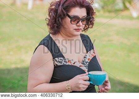 Middle Age Plus Size Woman Enjoying The Life. A Mature Lady With Excess Weight, Stylishly Dressed, M