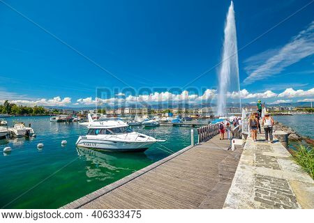 Geneva, Switzerland - Aug 15, 2020: Jet Deau Fountain, Symbol Of Geneva In Leman Lake. Tourists And