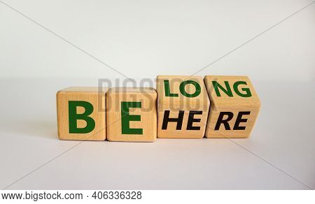 Be Here Belong Symbol. Turned Cubes And Changed Words 'be Here' To 'belong'. Beautiful White Backgro