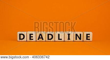 Deadline Symbol. Concept Word 'deadline' On Wooden Cubes On A Beautiful Orange Background. Business