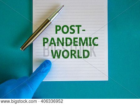 Post-pandemic World Symbol. Hand In Blue Glove With White Card. Concept Words 'post-pandemic World'.