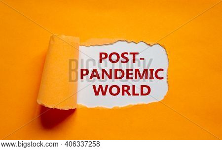 Post-pandemic World Symbol. The Words 'post-pandemic World' Appearing Behind Torn Orange Paper. Beau