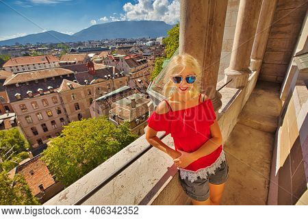 Happy Tourist Girl At Panoramic Terrace Of Geneva Cathedral Gothic Romanesque Of Saint-pierre In Swi