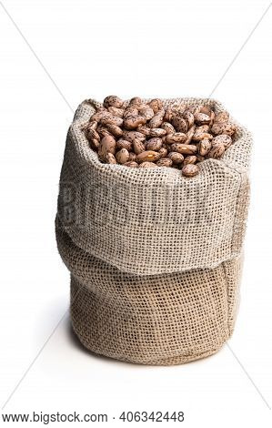Pinto  Beans In Sackcloth Bag Isolated On White Background
