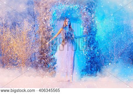 A magical fairy-tale world. Beautiful forest nymph in a magical winter forest.