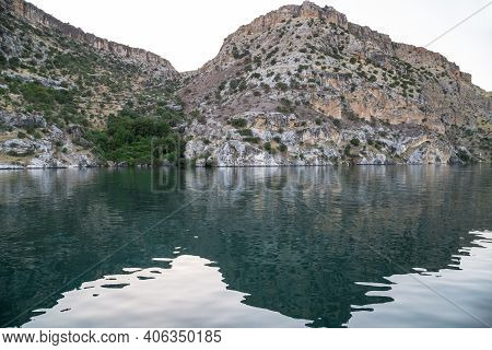 These Are The Rocky Banks Of The Euphrates River, Reflected In The Turquoise Waters Of The River In