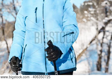 Female Hands In Gloves Holding Nordic Walking Sticks, Close-up. Active Lifestyle Concept. Nordic Wal