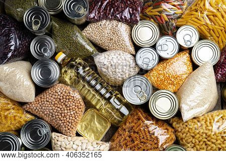 Donations Food With Canned Food On The Table Background. Donate Concept.