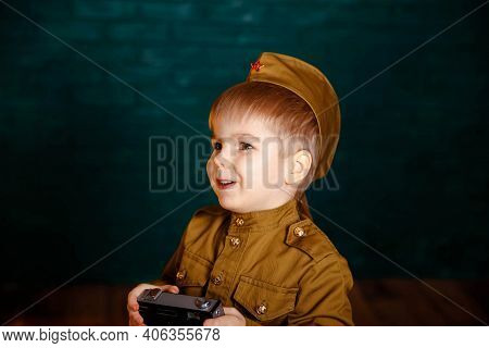 Portrait Of Happy Young Boy In Camouflage. Boy Playing Soldier. Army Thee Kid. Funny Smiling Prescho