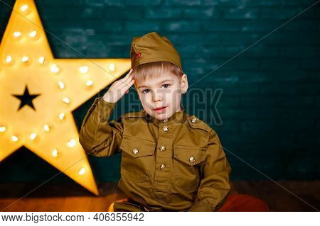 Young Soldier. Little Patriot. Army Thee Kid. Boy Playing Soldier. Portrait Of Happy Young Boy In Ca