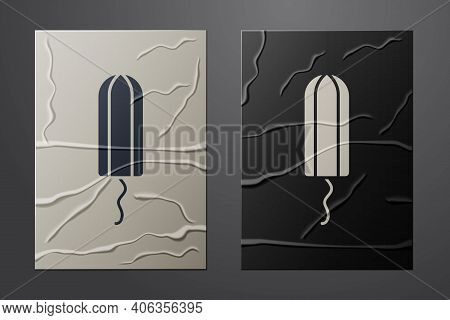 White Menstruation And Sanitary Tampon Icon Isolated On Crumpled Paper Background. Feminine Hygiene