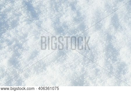 Background Of Fresh Snow Texture. Top View Of The Natural Pure Snow In Winter With Copy Space. Beaut