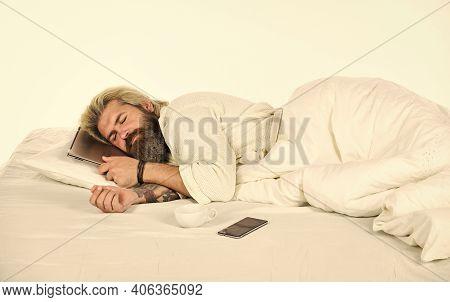 Blue Light Effect. Man With Sleepy Face Lies On Pillow With Laptop. Deep Sleep Concept. Man With Bea