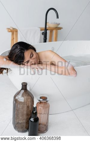 Young Woman In Lather Relaxing While Taking Bath In Modern Bathroom