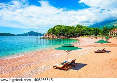 Beautiful Beach With Chaise Lounges Near Budva, Montenegro. Famous Travel Destination. Summer Landsc