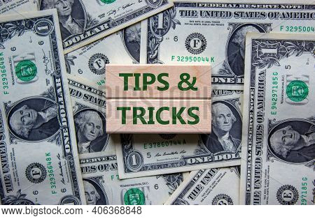 Tips And Tricks Symbol. Wooden Blocks With Words 'tips And Tricks'. Beautiful Background From Dollar