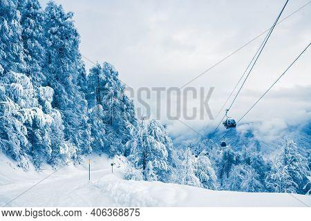 Ski Slope And Gondola Lift In Winter Ski Resort. Rosa Khutor, Sochi, Russia. Beautiful Snow-covered