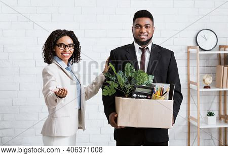 Smiling Black Guy With Personal Stuff Being Welcomed To Company Office By His Lady Boss. African Ame