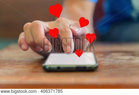 The Man Touch The Screen For Show Heart Emotion To Social Media On Smartphone
