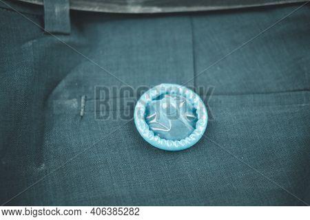 Blue Condom On Slack Pants Background. Prevent Infection, Having Safe Sex For Valentine's Day