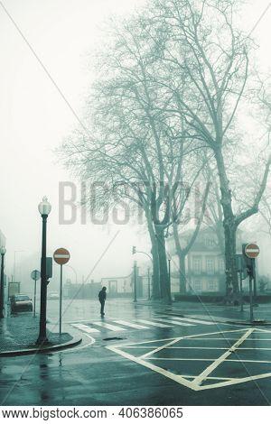 View of foggy deserted street, Porto, Portugal.