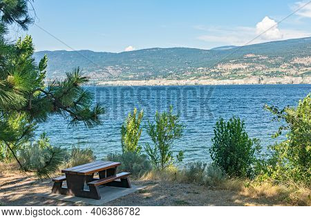 Recreation Area With Beautiful Overview Of A Lake And Mountains.
