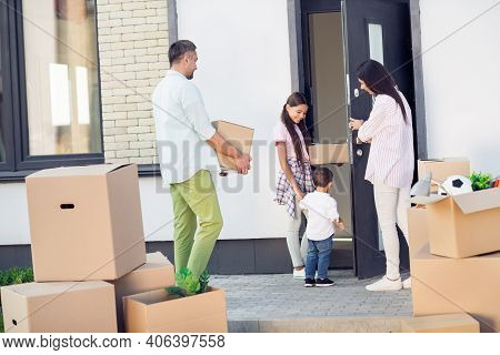 Photo Portrait Of Big Family Moving Into New House Father Carries Big Box Inside Outdoors On Street