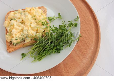 Egg Salad Sandwich With Whole Wheat Toasted Bread And Microgreens On Plate On White Background. Heal