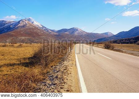 Road Trip Through The Balkans. Winter Landscape With Road In Valley Of Dinaric Alps.  Bosnia And Her