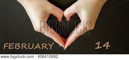 February 14 Valentines Day Symbol. Woman Making Heart Shape On Dark Background. Words February 14. H