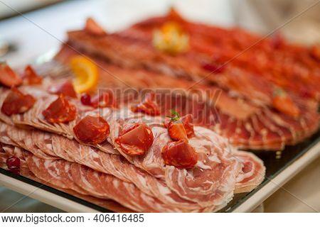 Chorizo Sausage And Salami, Thin Cut. Spanish Salami On The Wood Background With , Paprika, Pepper.