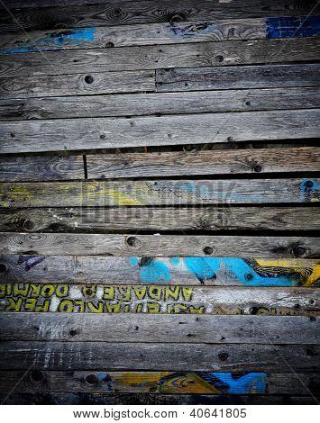 wood dirty board and graffiti text
