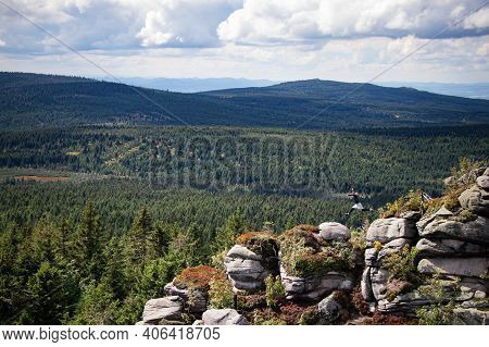 Young Man Enjoys His Freedom Of Jumping Rocks In The Jizera Mountains In The North Of The Czech Repu