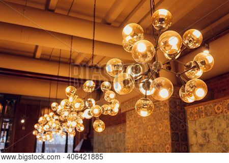 Beautiful Chandelier. Modern Chandelier Hanging Under Ceiling.