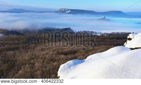 Zirkelstein Shinning Above Freeze Mist. Cold Winrer Morning View. Dry Spruce Forest.  Sandstone Bloc