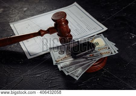 Car Keys On Dollar Banknotes And Wooden Judge Gavel With Contract