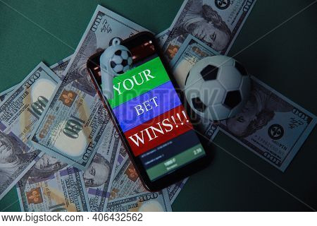 Ball, Whistle And Smartphone With Bet Application On Dollar Bills And Green Background. Gambling And