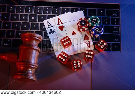 Law For Online Casino. Wooden Judge Gavel And Cards With Playing Chips And Dices
