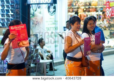 PATONG, THAILAND - NOV 10:  Unidentified women offering massage on the street of Patong at night. This neighborhood is famous from the nigh life and sex tourism, Patong, Thailand, Nov.10, 2012.
