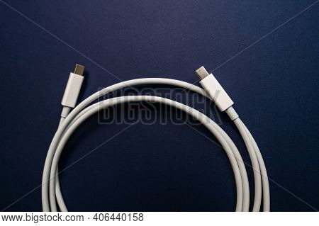 Usb-c Cable Manufactured For Fast Data And Peripheral Transmission - Isolated On Blue Background