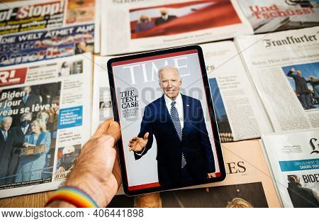 Paris, France - Jan 21, 2021: Man Holding Digital Tablet With Time Magazine Cover Featuring Joe Bide