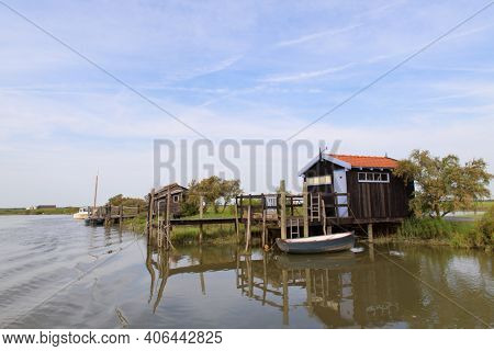 French wooden oyster huts in landscape in the France Charente Maritime