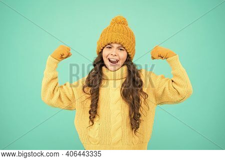 Energy Charge. Child Cute Girl Hat And Gloves Show Biceps Gesture Of Power And Strength. Feel So Pow