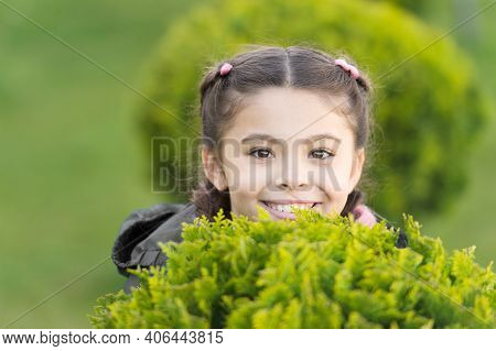 Playful Little Girl With Trendy Hairstyle. Parks And Outdoor. Autumn Weather. Cypress Tree. Happy Pl